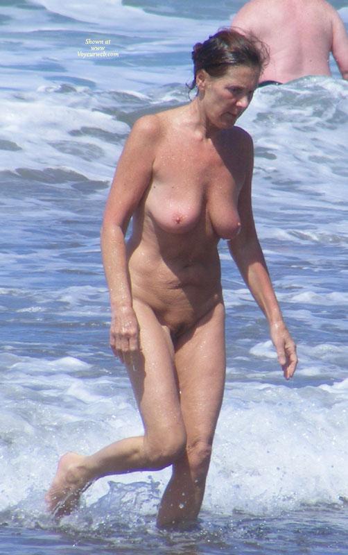 Nude mateur voyeur in beach