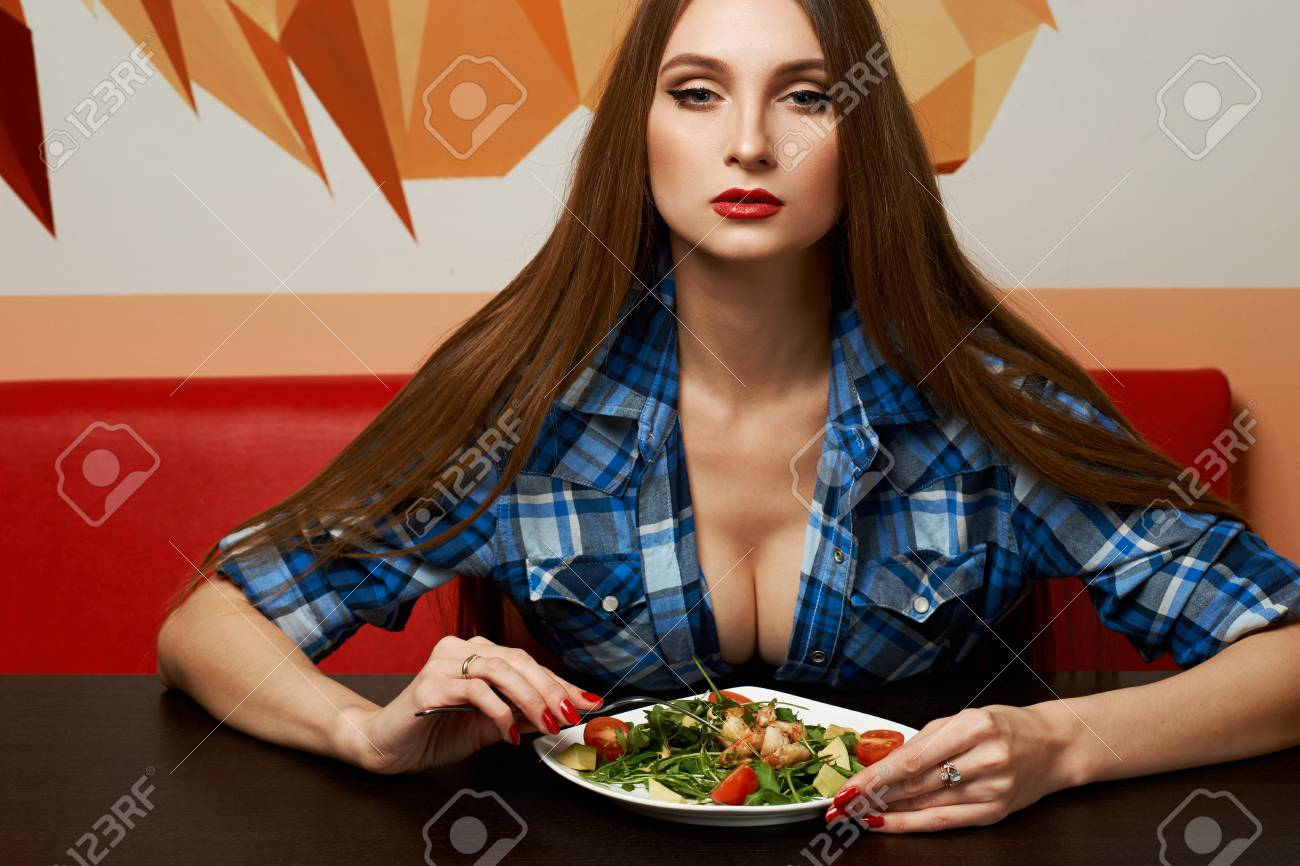Sexy girl at dinner table