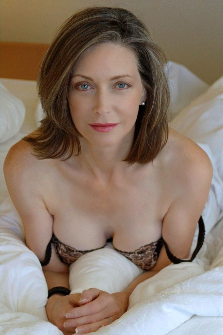 Hot mature woman in bed