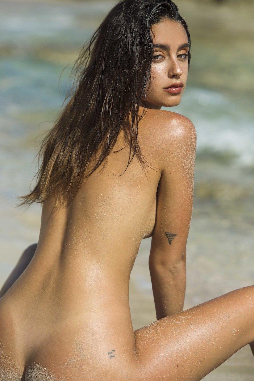 Nude model in beach