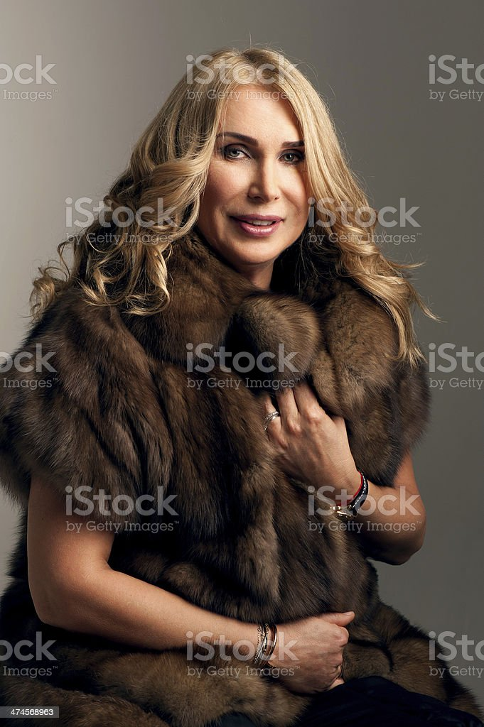 Mature woman in fur