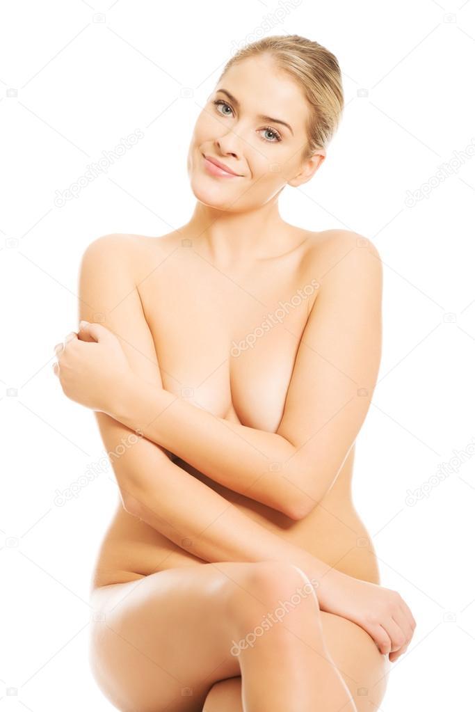 Girl crossed legs naked sitting