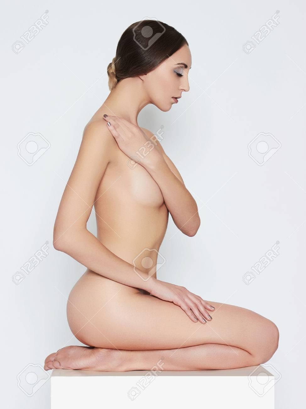 Naked girls sitting on