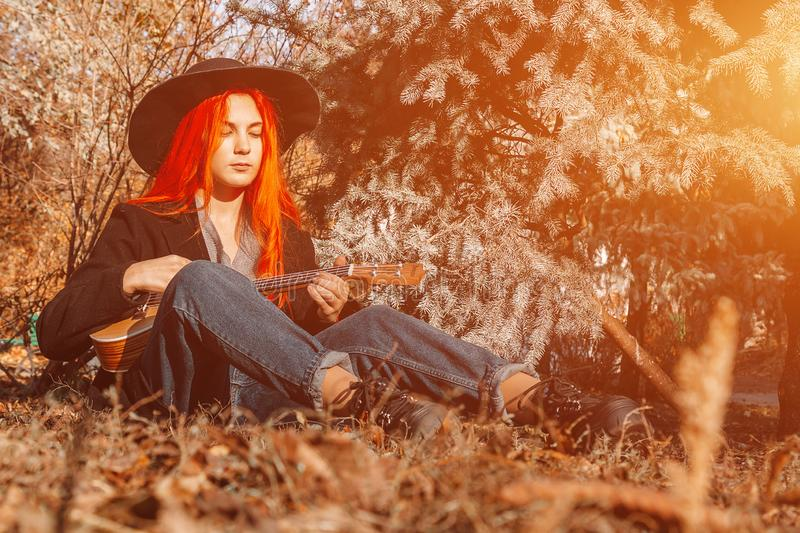 Nude redhead outdoors on country