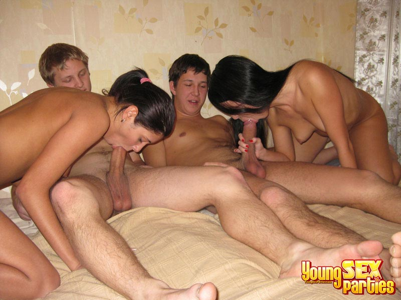 Nude couple with friends