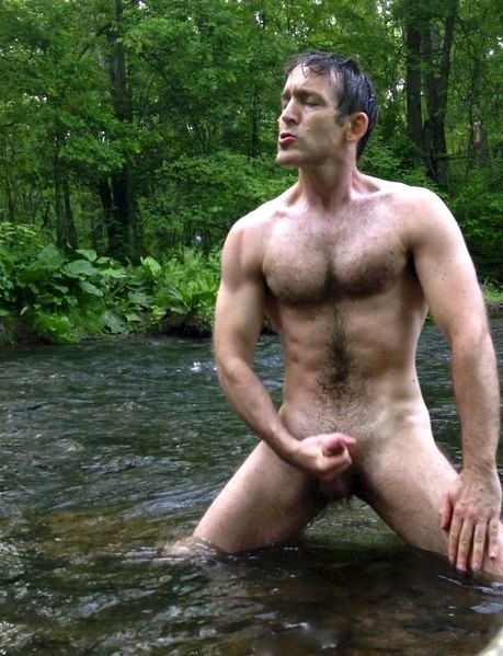 Hairy nude man outdoors