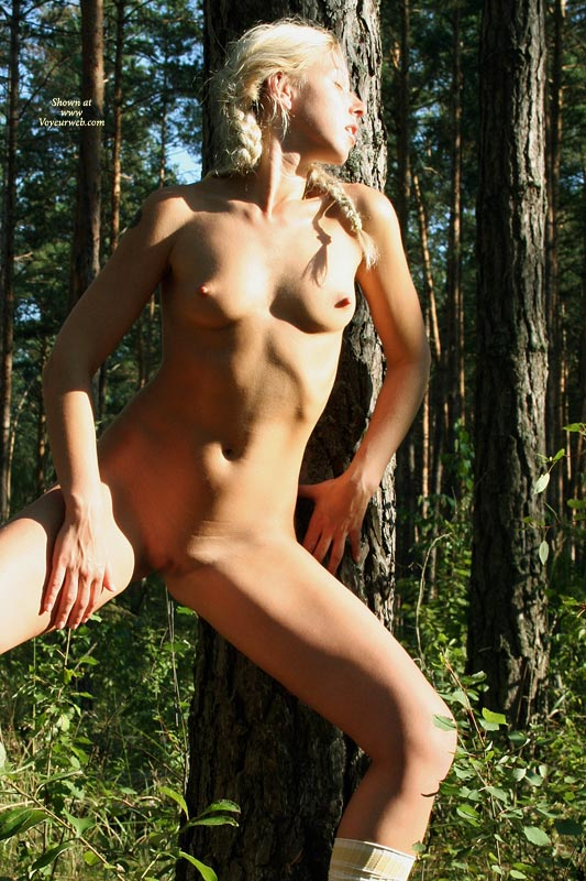 Nude blonde girl with braids