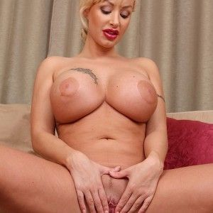 Mature nudist spreading thick thighs