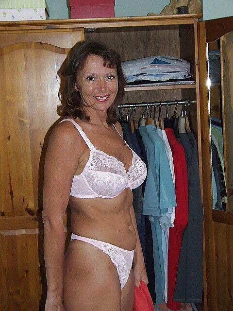 Older woman cougar in lingerie