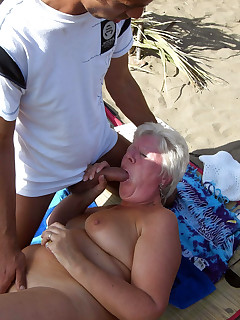 Black granny showing pussy on nude beach