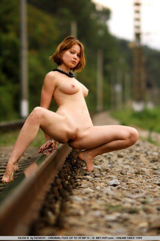Nude girls on railroad tracks