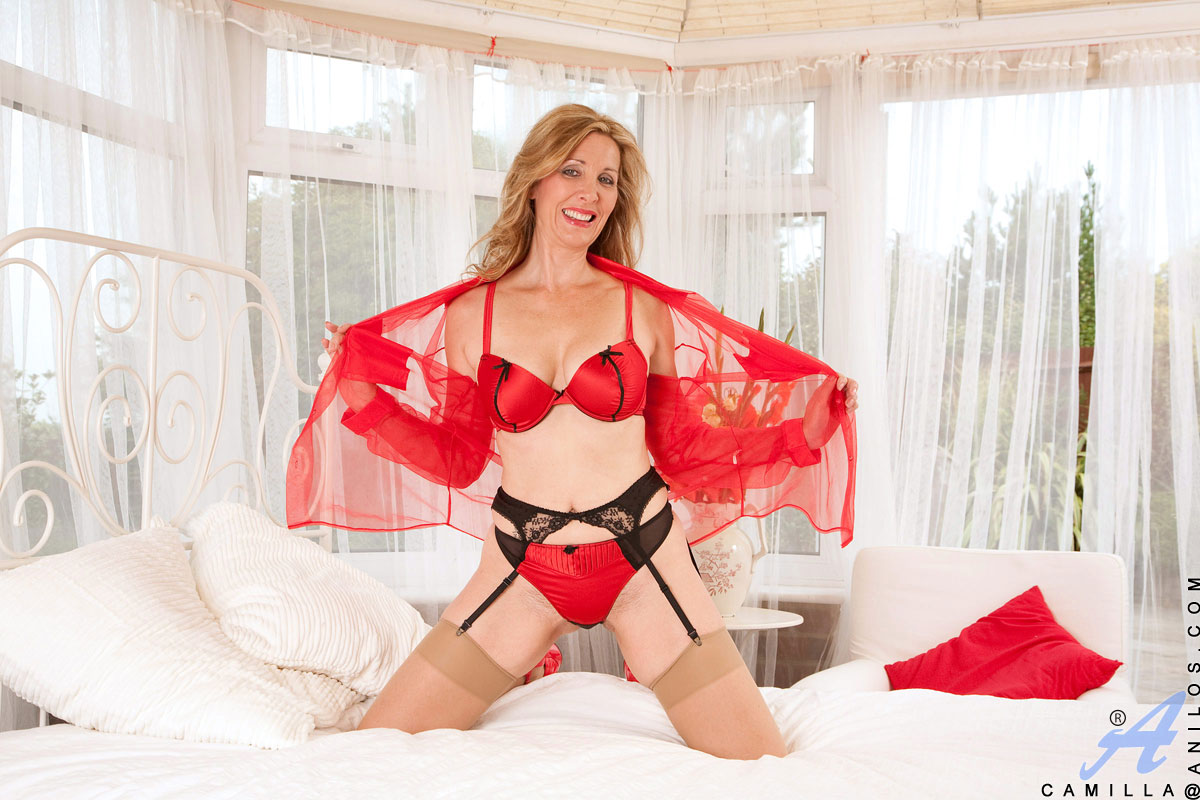 Cougar in lingerie masterbating