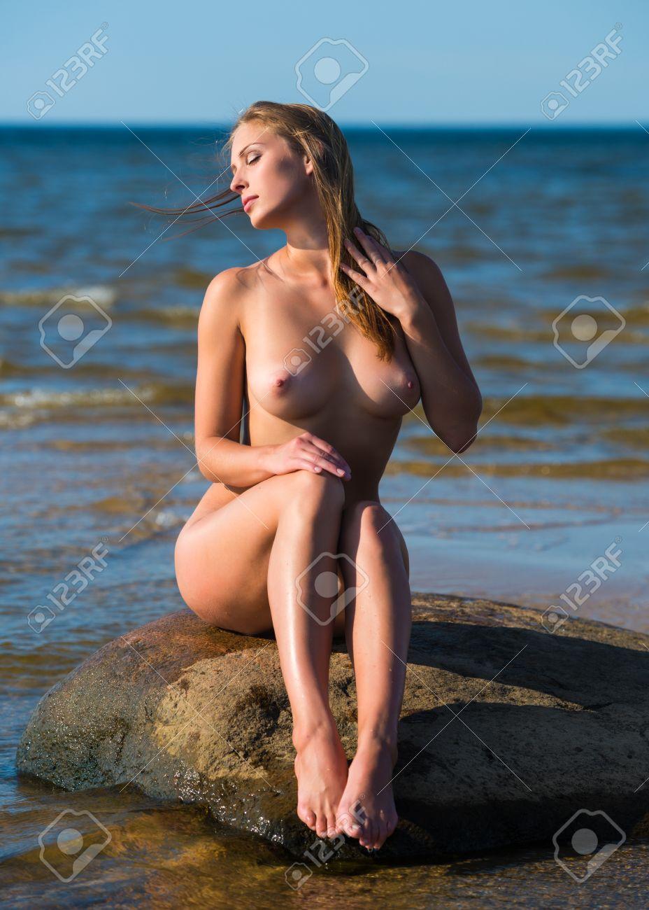 Beautiful naked women on beach