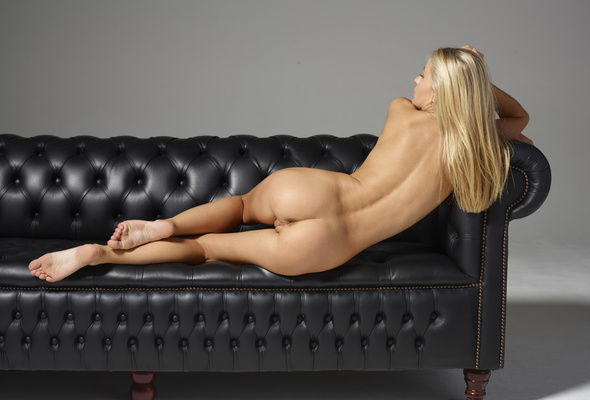 Nude black girl on leather couch