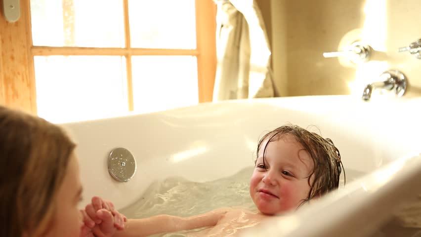 Girls and boys taking baths