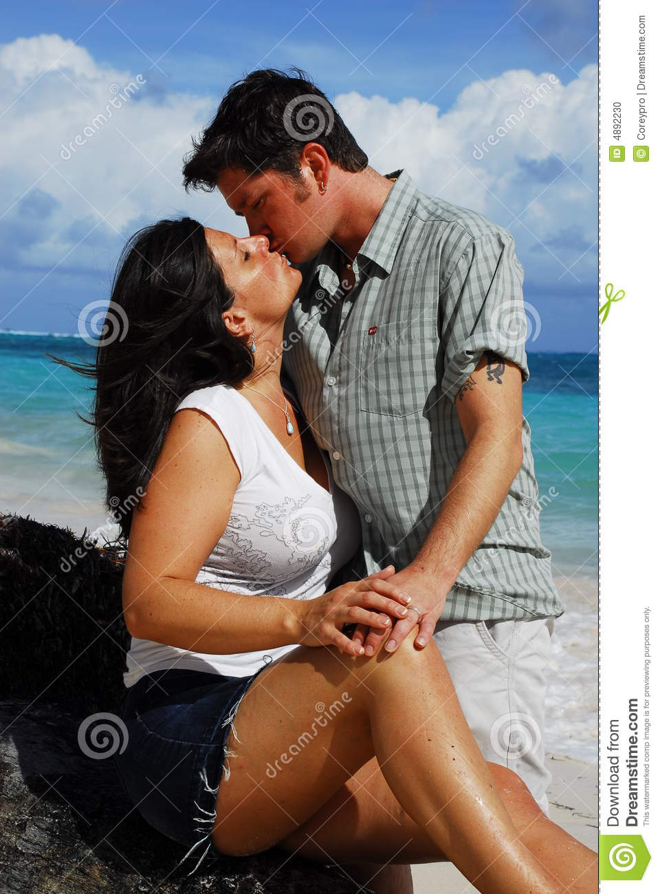 Romantic couple making love on the beach